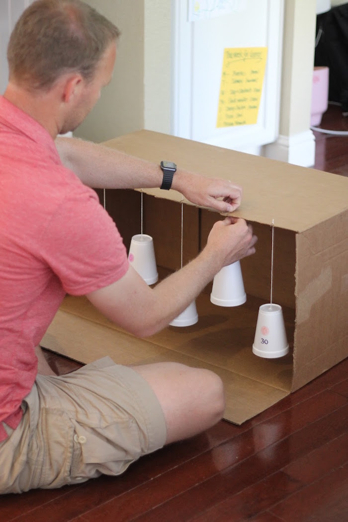 attaching the styrofoam cups to the box art and craft ideas for kids target practice for kids