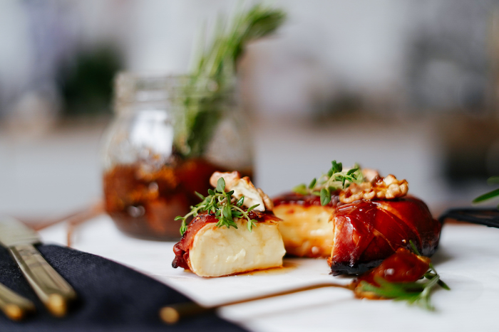 baked brie wrapped with prosciutto garnished with jam thyme walnuts thanksgiving food ideas