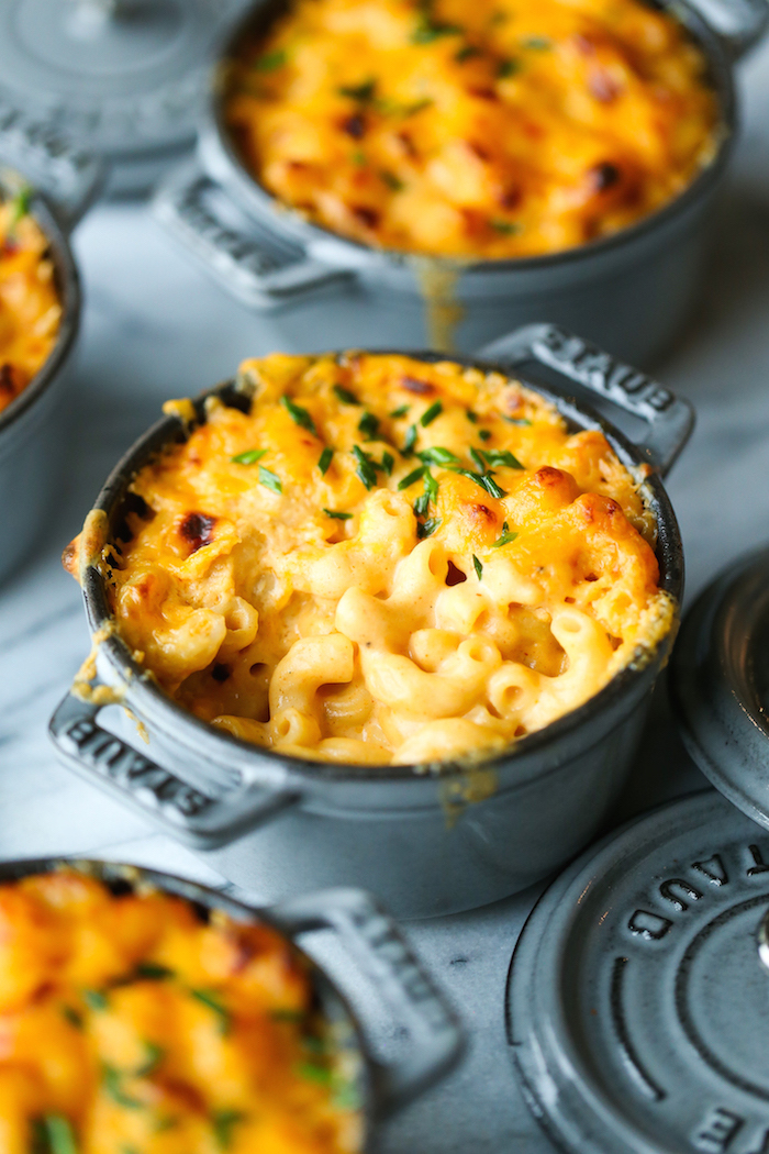 baked mac and cheese inside small black casserole dish thanksgiving vegetable side dishes placed on marble surface