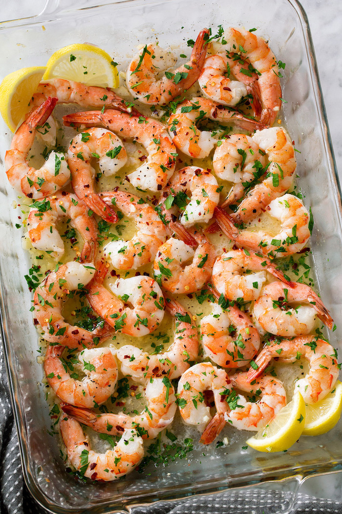 baked shrimp in lime sauce garnished with chopped parsley shrimp recipes inside glass casserole dish