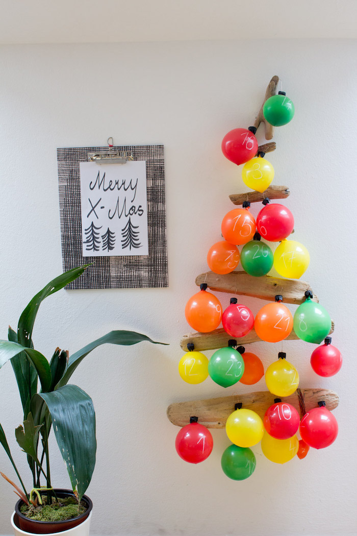 balloon advent calendar tree hanging on white wall advent calendar balloons in different colors attached to wood logs