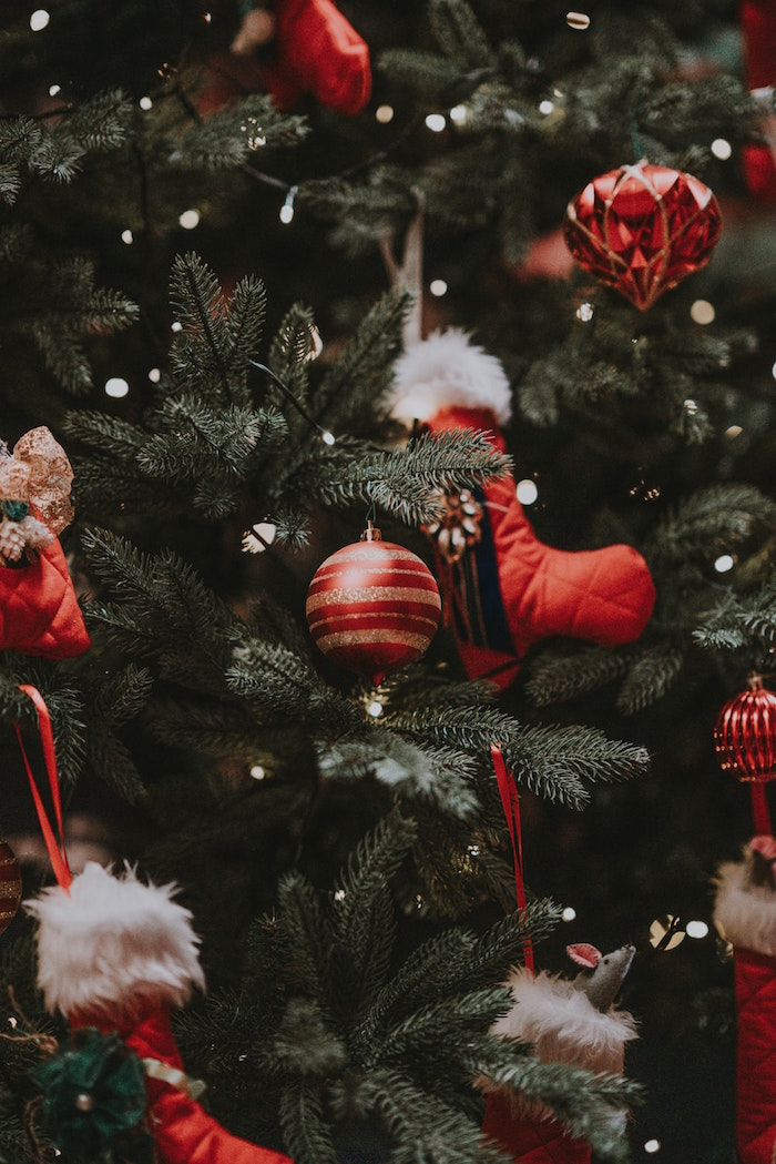 baubles in red and gold stockings hanging on christmas tree christmas wallpaper tumblr decorated with fairy lights