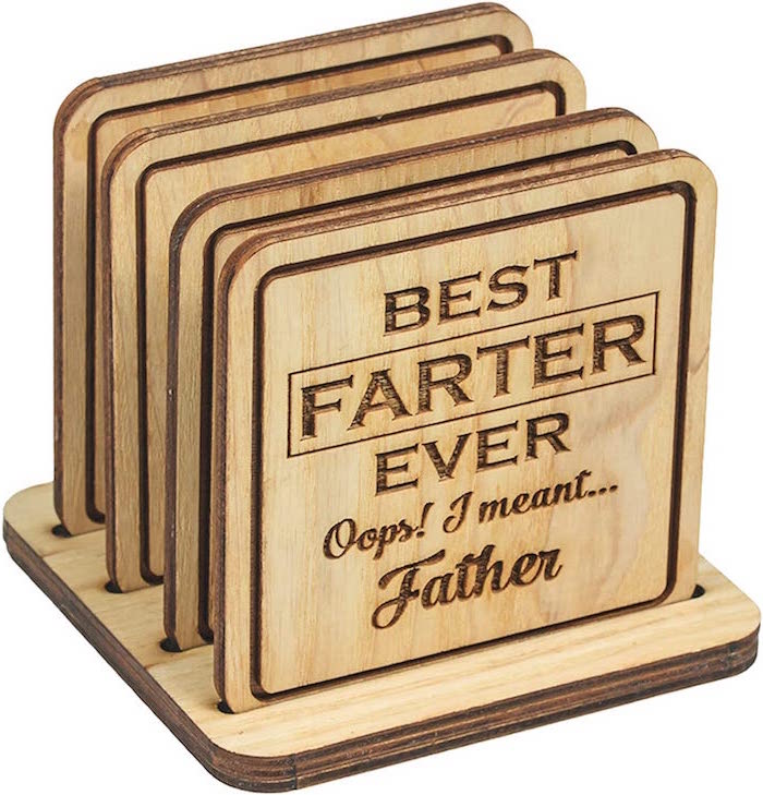 best farter ever oops i meant father best gifts for dad funny wooden coasters set photographed on white background