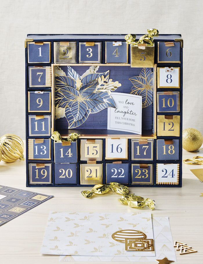 blue and gold carton boxes decorated with numbers unique advent calendars candy inside them