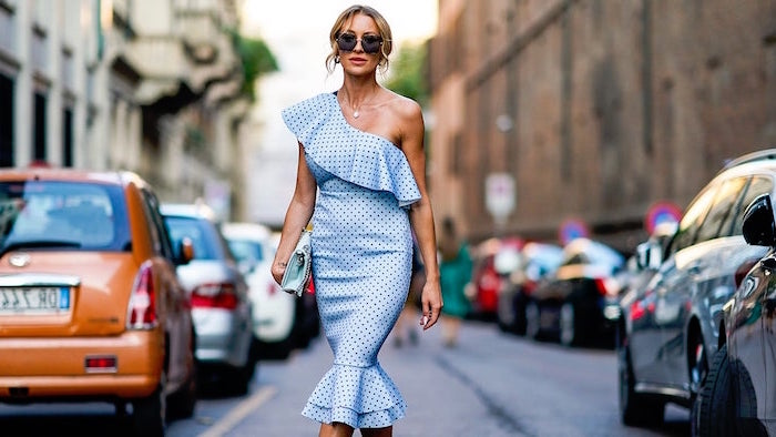 blue dress with fringe and black dots long sleeve wedding guest dresses worn by blonde woman with hair in high updo