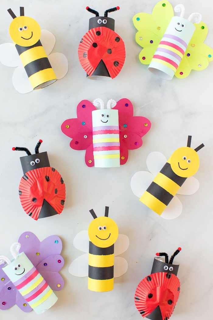 butterflies bees and lady bugs made out of toilet paper rolls and crepe paper indoor activities for kids white background