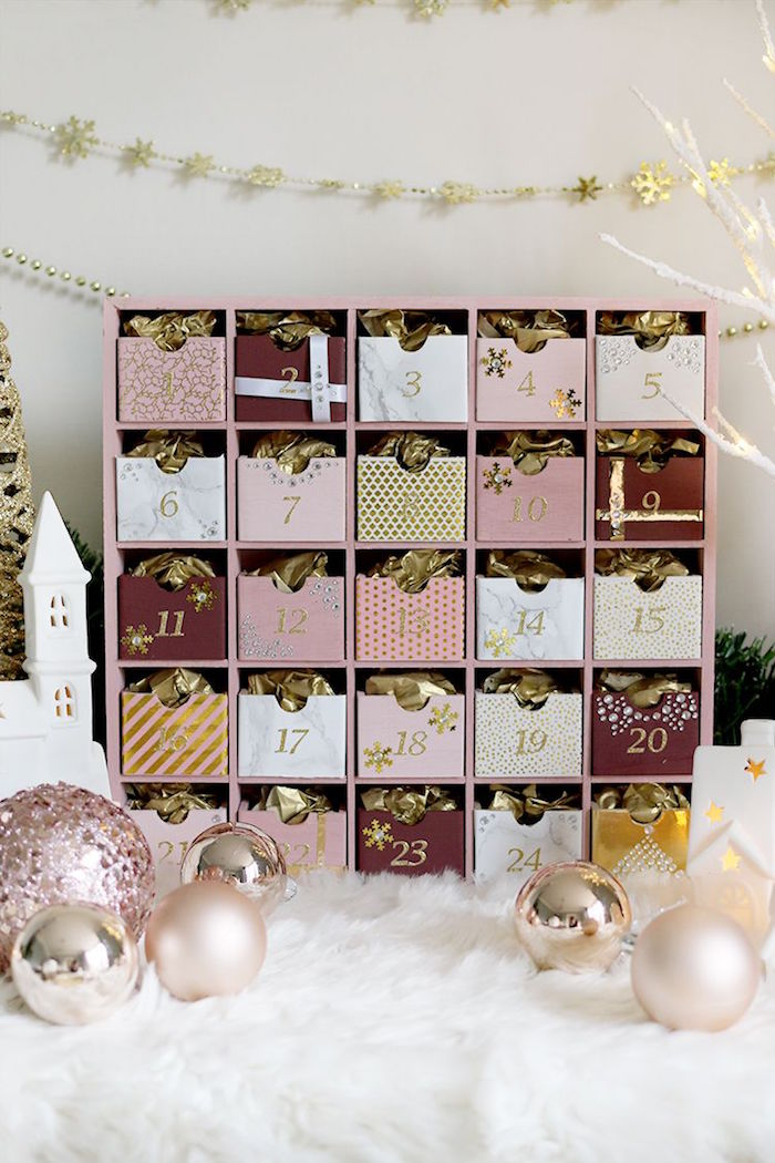 calendar in rose gold diy advent calendar ideas with small wooden boxes filled with candy and gold paper