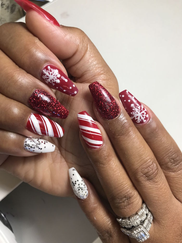 candy cane snowlakes decorations on medium length coffin nails holiday nail designs red white and red glitter nail polish
