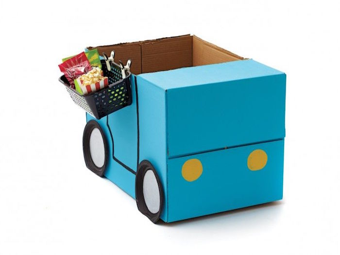 car made out of box painted in blue with paper plates for wheels craft ideas for kids basket with candy attached to the side