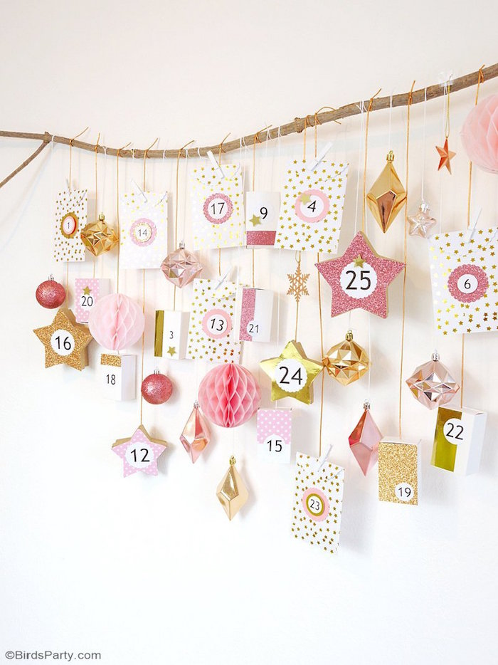 christmas tree advent calendar small boxes labeled with numbers hanging with white and gold string from wood branch