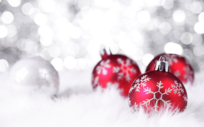 christmas wallpaper iphone close up photo of three red baubles with snowflakes photographed on white background