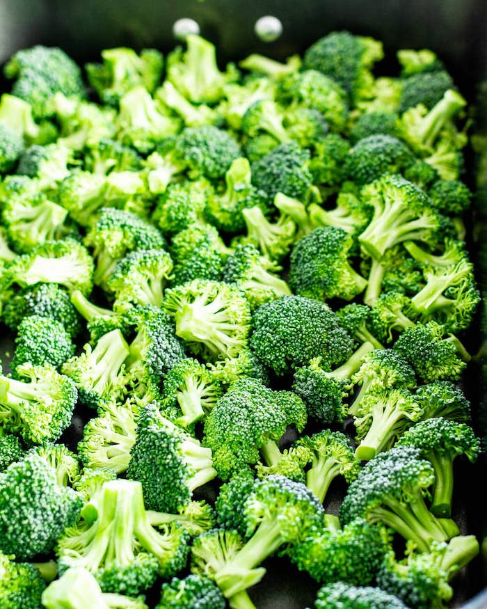 close up photo of lots of broccoli arranged in baking dish what to make on thanksgiving