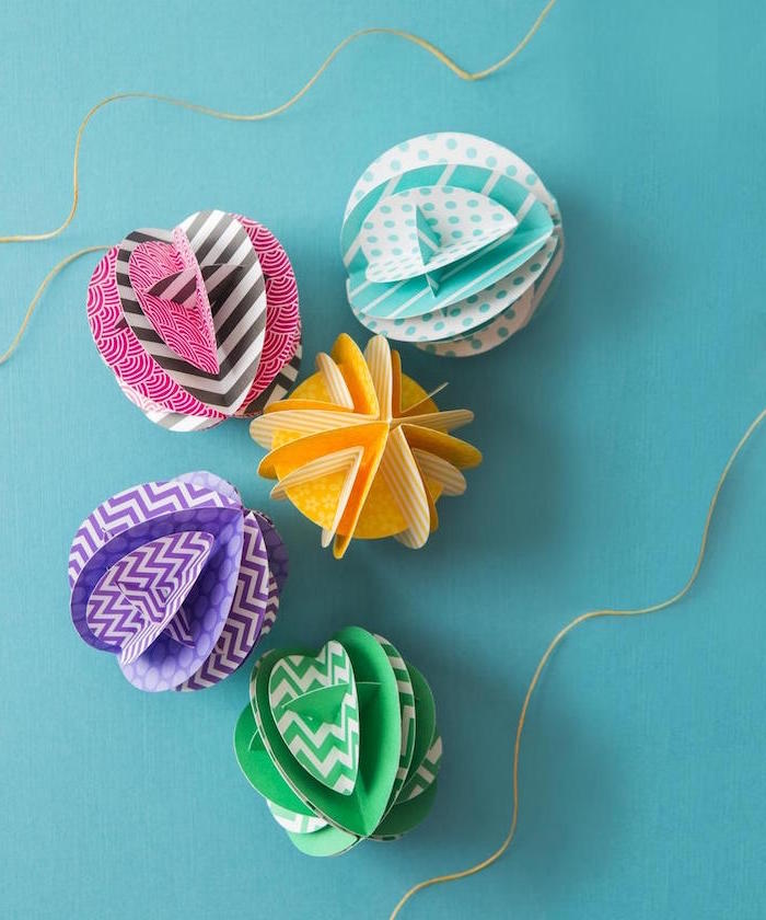 crafting with paper fun things to do at home round figurines made in yellow green pink blue purple tied with twine