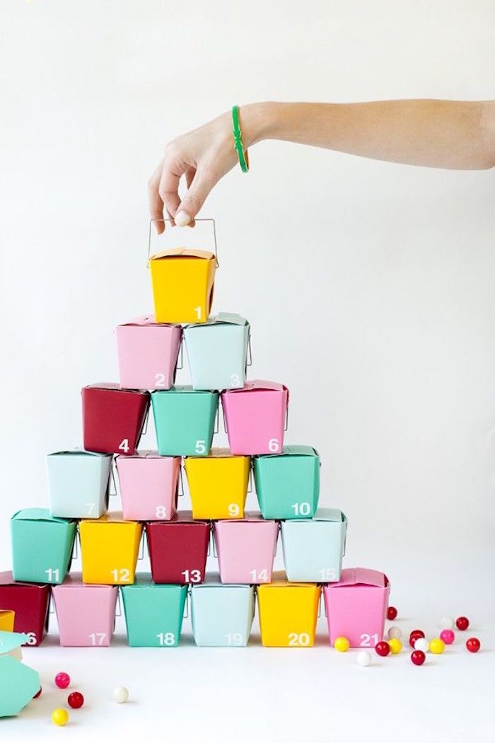 diy tutorial step by step diy advent calendar ideas with take out boxes in different colors labeled with numbers filled with candy