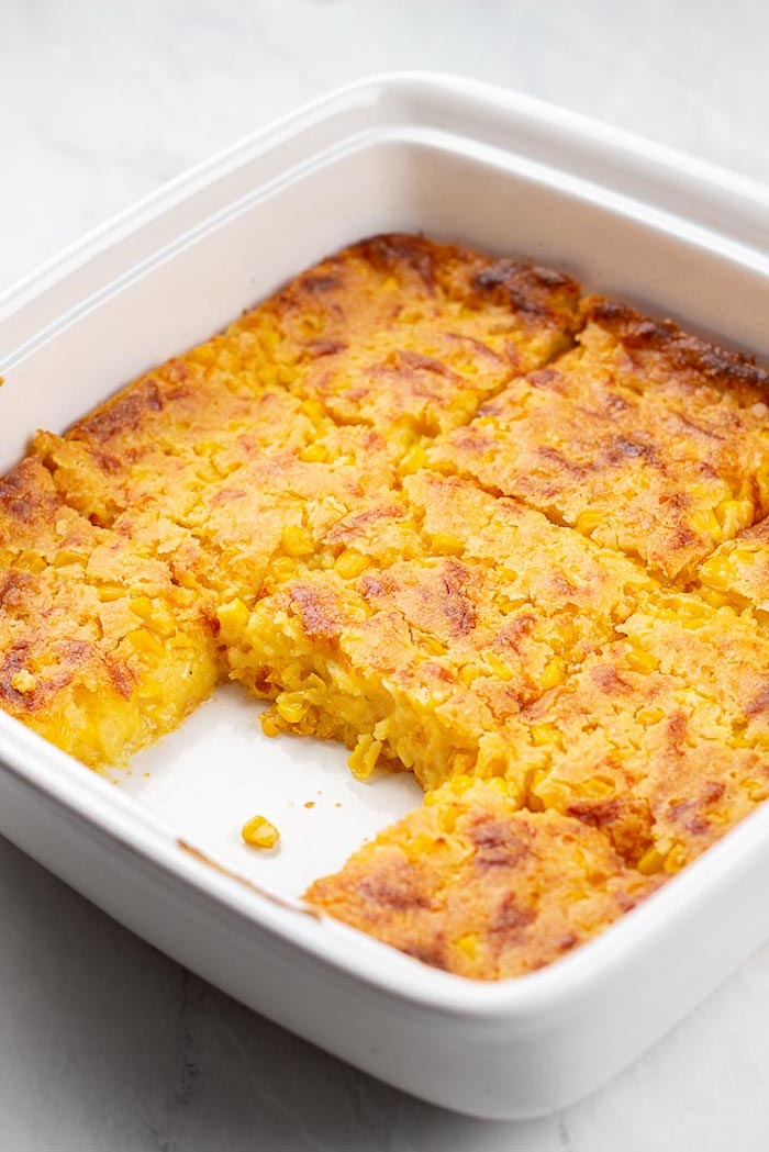 easy thanksgiving side dishes corn casserole baked inside white casserole piece missing placed on white surface