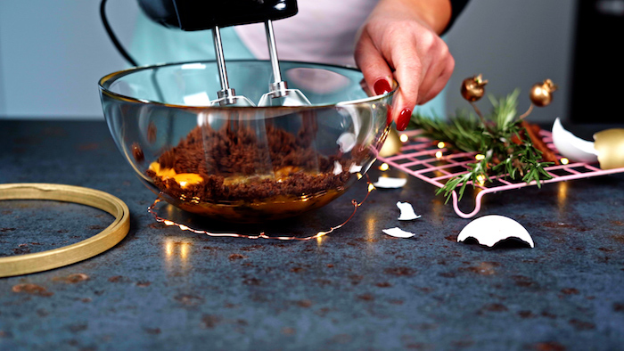 eggs brown sugar being beaten with a hand mixer in large glass bowl alternative christmas dinner ideas