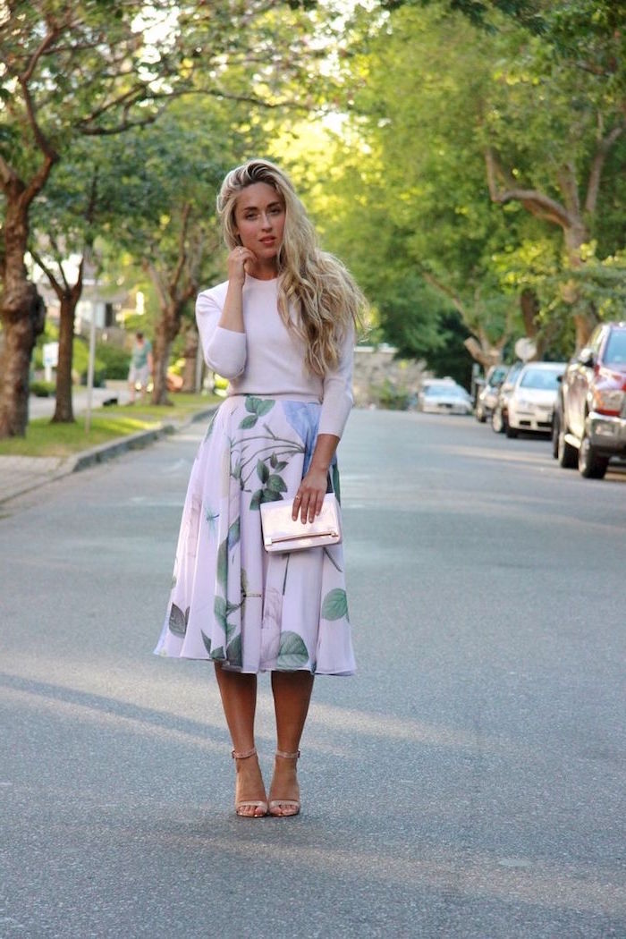 elegant dresses for wedding guests woman with long blonde hair wearing pink floral skirt with light pink blouse nude sandals
