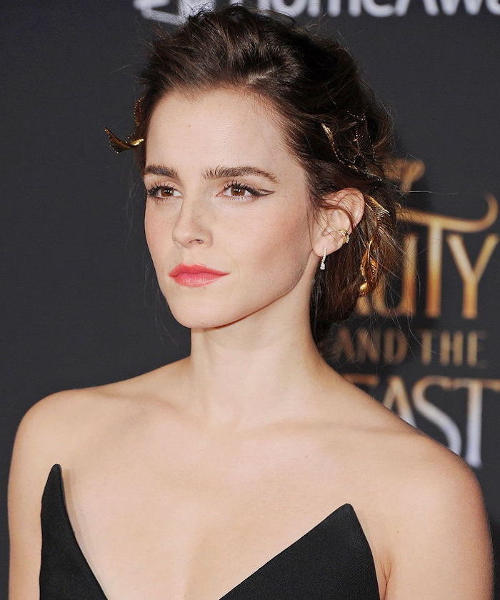 emma watson on the red carpet wearing black strapless dress eyeliner for hooded eyes hair in low messy updo