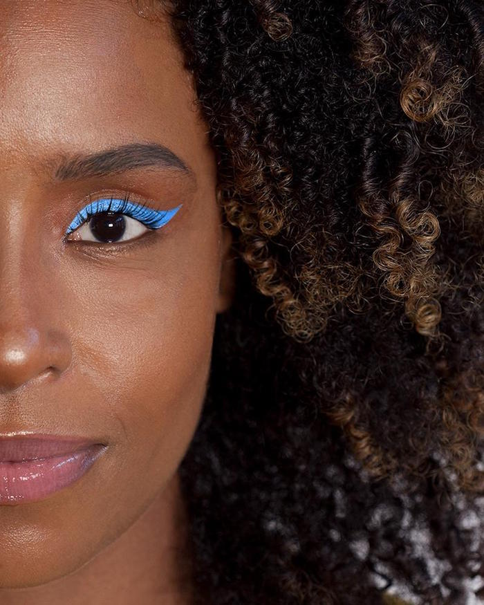 eyeliner for almond eyes blue eyeliner with sharp edge on woman with brown eyes black curly hair