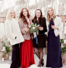 four women wearing coats black purple and red dresses affordable wedding guest dresses holding glasses