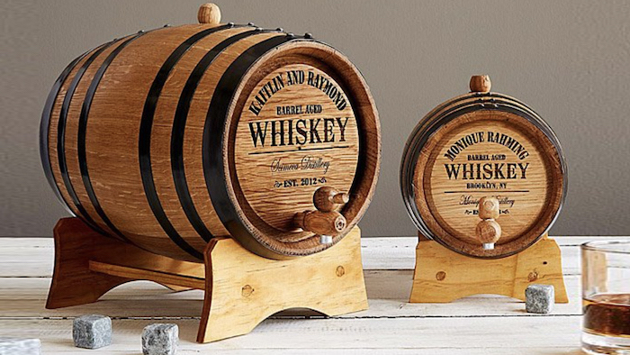 good gifts for dad one big and one smaller wooden whiskey barrel placed on wooden surface whiskey glasses