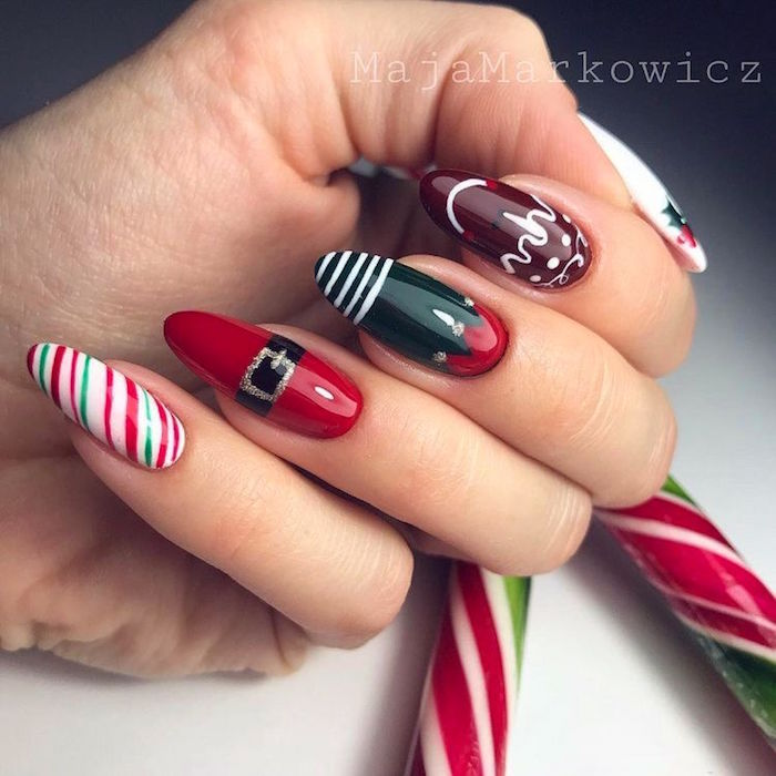 green and red nail polish on long almond nails christmas nails 2020 different decoration on each nail inspired by christmas