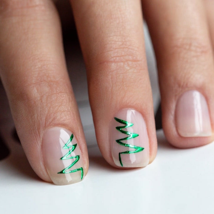 green christmas tree outline on middle and ring fingers christmas nails 2020 minimalistic nail design on short squoval nails