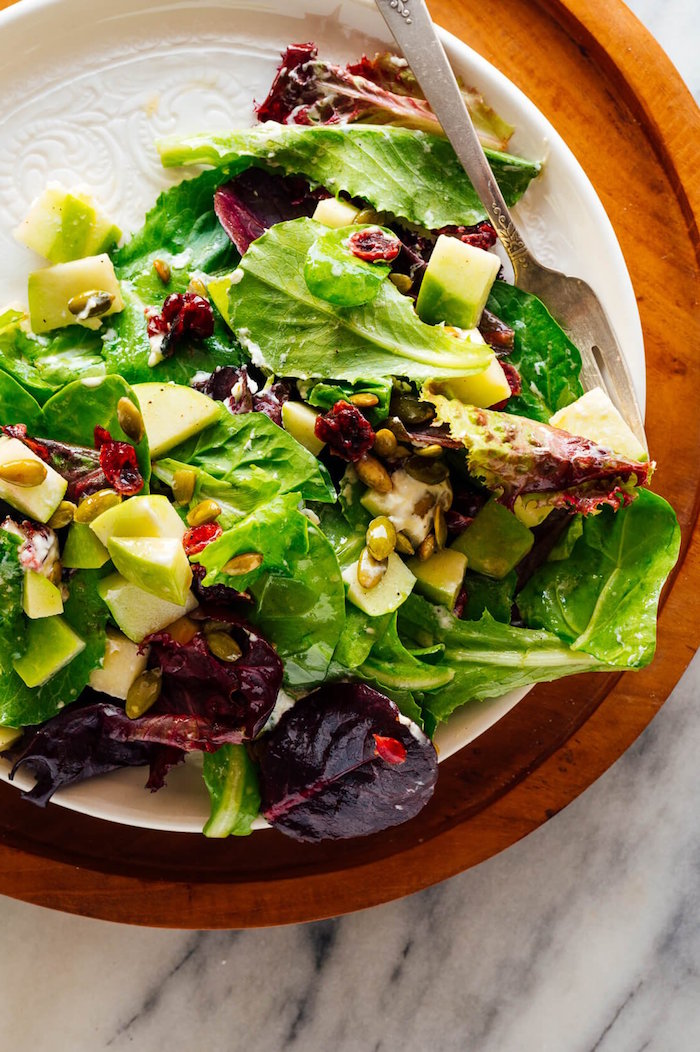 green salad spinach and apples salad christmas food ideas with pine nuts and dried cranberries
