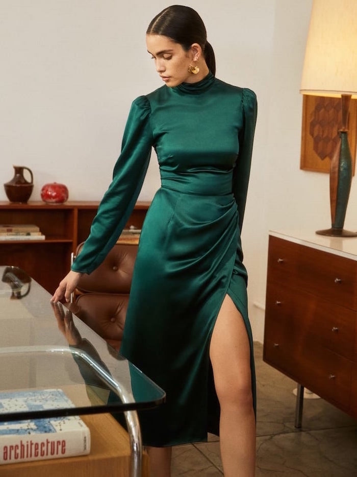 green satin dress with long sleeves worn by woman with long black hair in low ponytail semi formal dresses for wedding