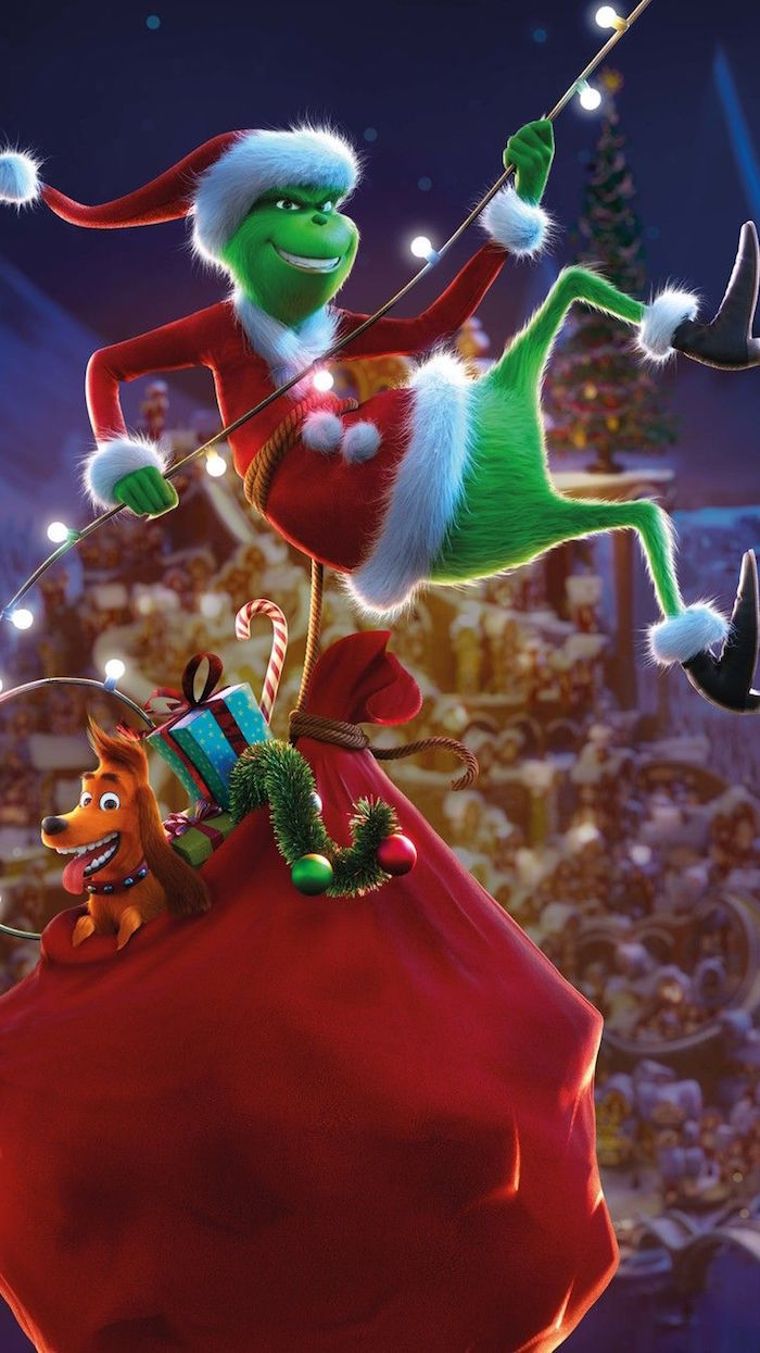 grinch carrying bag full of presents christmas desktop wallpaper climbing up string of lights animation