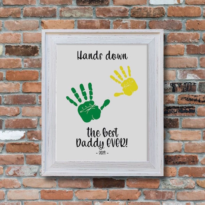 hands down the best daddy ever with two handprints christmas gifts for dad poster hanging on brick wall