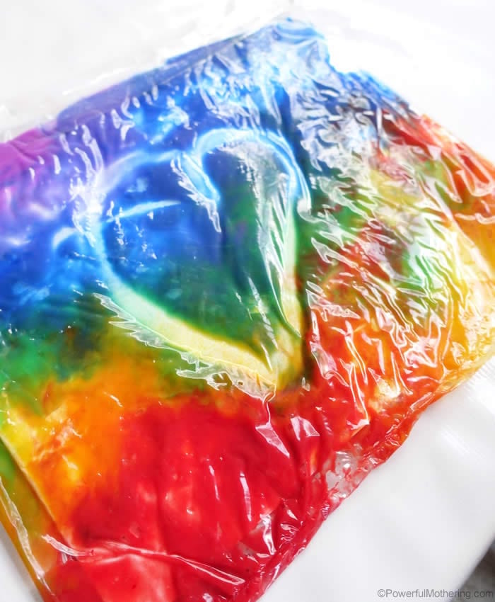 heart drawn into plastic bag filled with paint in all colors of the rainbow what to do on a rainy day
