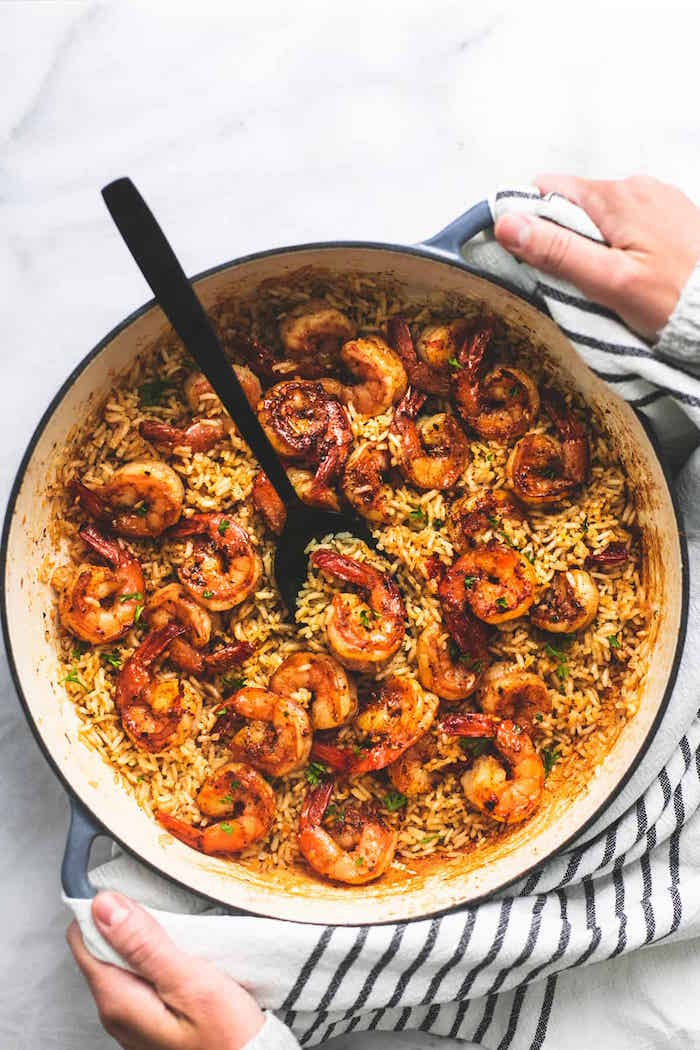 how long to cook shrimp one pan shrimp rice cooked in skillet stirred with black spoon placed on marble surface