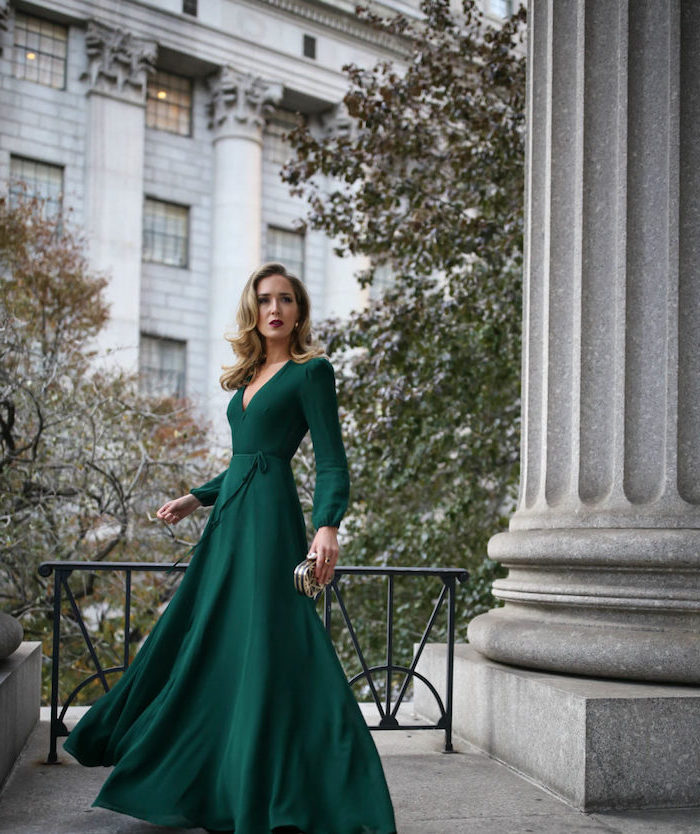 how to dress for a wedding blonde woman wearing long green dress with long sleeves v neckline