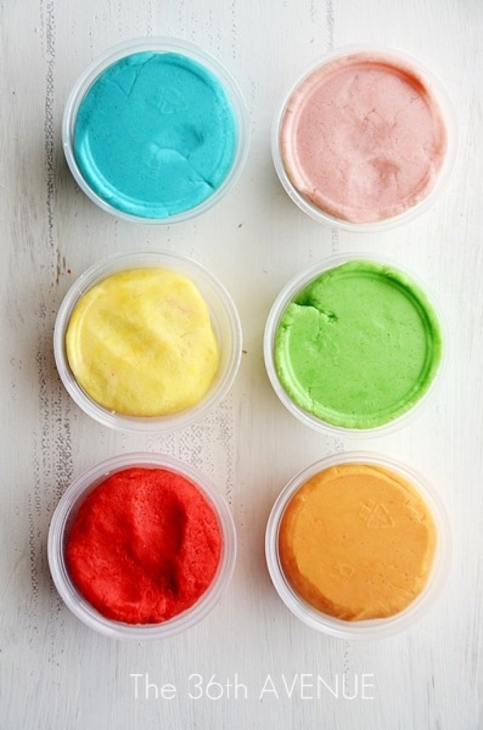 how to make play dough with kool aid things to do with kids at home six plastic cups with blue pink yellow green red orange dough on white surface