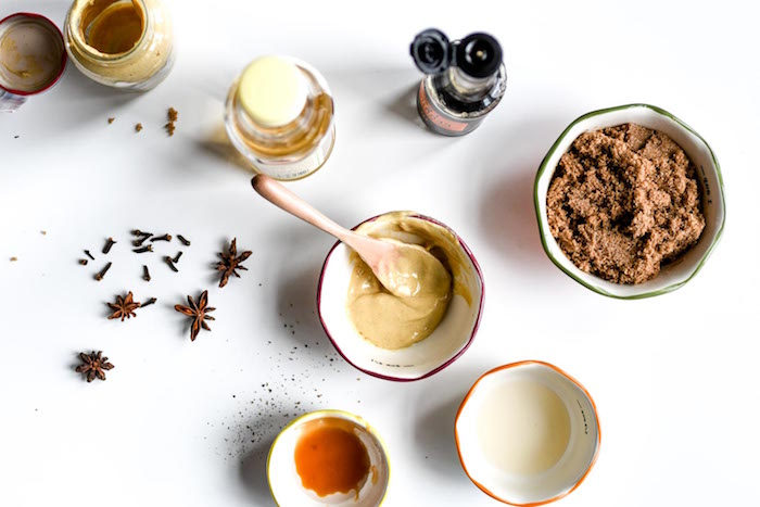 ingredients for ham glaze in small white bowls christmas dinner 2020 star anise placed on white surface