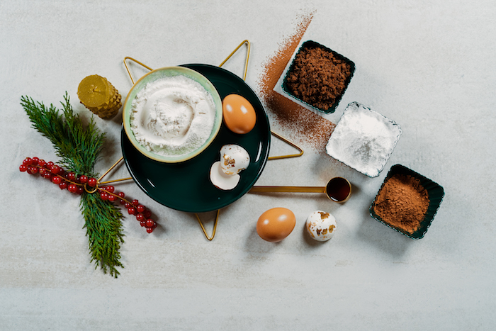 ingredients for yule log recipe easy christmas dinner ideas sugar flour eggs arranged on white surface