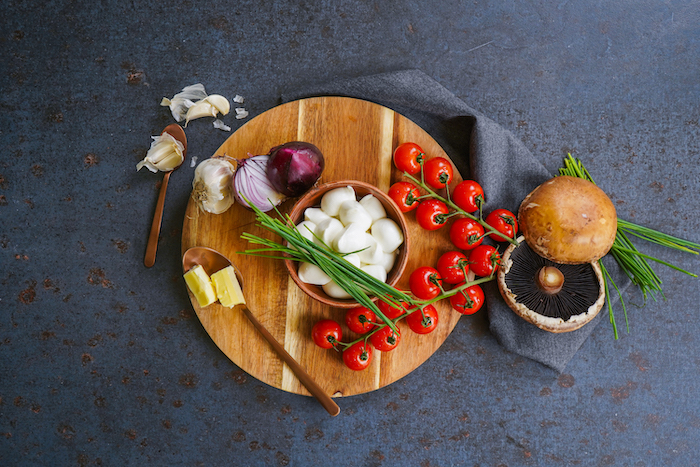 ingredients laid out on gray surface what to make on thanksgiving stuffed portobello mushrooms recipe