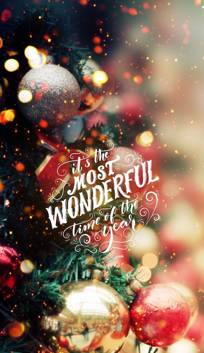 its the most wonderful time of the year written in white cursive christmas desktop wallpaper close up photo of decorated christmas tree