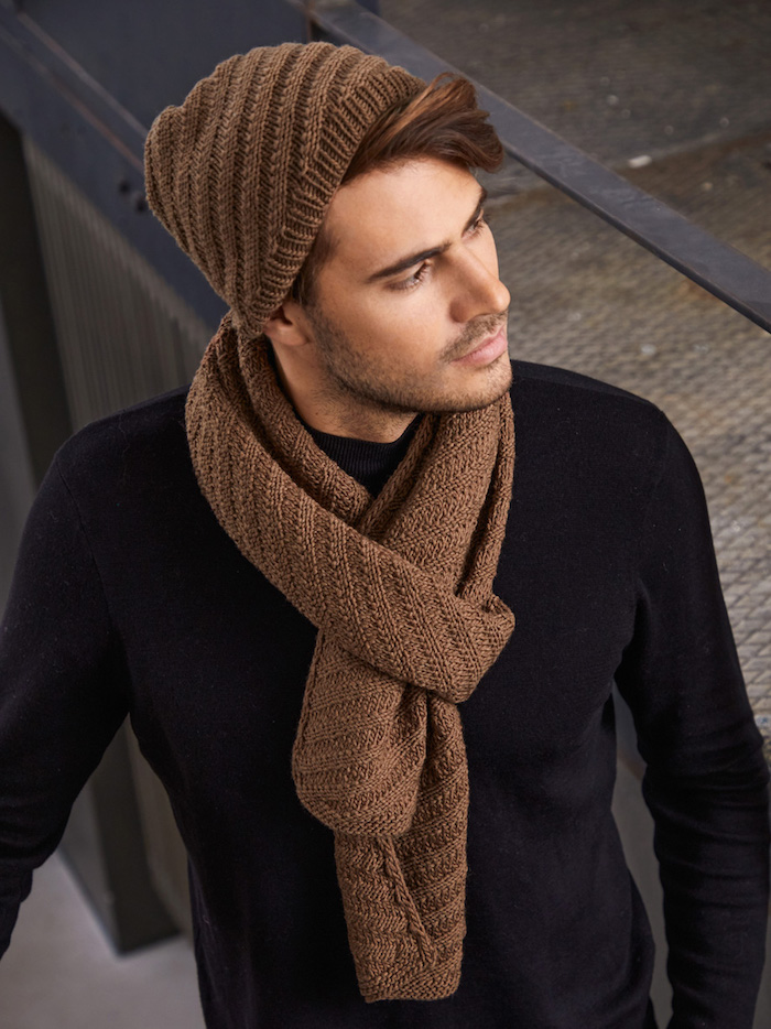 man wearing black sweater christmas gift ideas for dad knitted brown scarf and beanie set