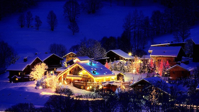 mountain village with houses covered with snow and lights christmas wallpaper iphone forest around it