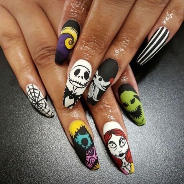 nightmare before christmas inspired nails in different colors christmas nails long coffin nails