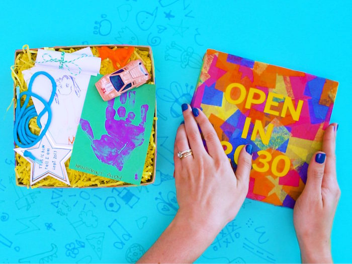 open in 2030 written on top of decorated carton box filled with memories art and craft ideas for kids how to make a time capsule