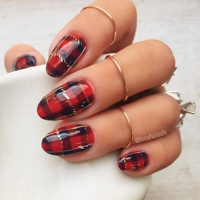 plaid decoration on each nail in red black and gold holiday nails 2020 medium length almond nails