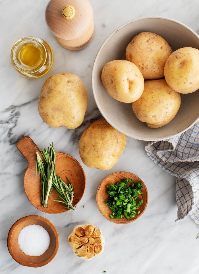 potatoes in a bowl garlic salt pepper rosemary olive oil thanksgiving vegetable side dishes mashed potatoes recipe