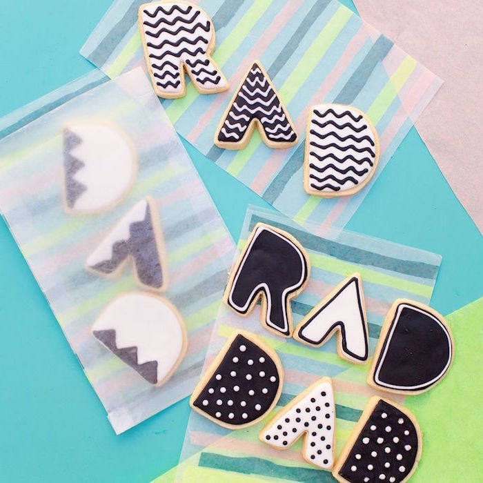 rad dad cookies decorated with black and white icing unique gifts for dad placed inside bags made from rice paper
