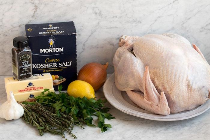 raw turkey butter salt black pepper onion garlic herbs easy christmas dinner ideas ingredients for roasted turkey