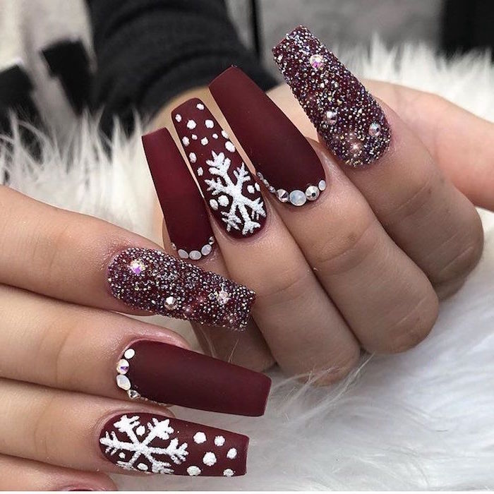 red matte nail polish decorations with rhinestones and white snowflakes christmas nails very long coffin nails