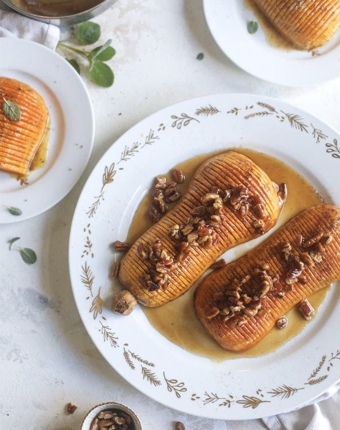 roasted butternut squash with honey cinnamon walnuts best thanksgiving sides placed on white plate on marble surface