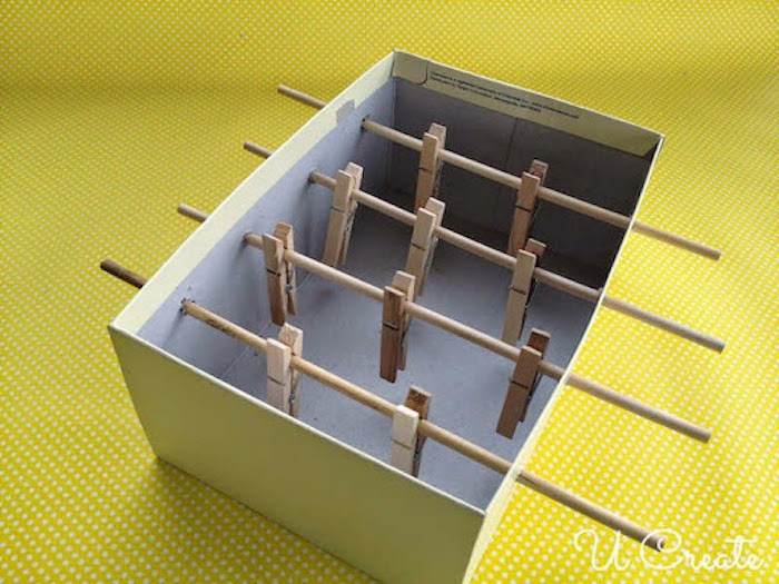 shoe box with wooden sticks inserted in it things to do with kids at home clothespins attached to the sticks